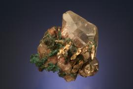 Calcite with copper and silver, Quincy Mine, Houghton County, Michigan. A superb specimen of copper included calcite crystals with silver crystals. From the collection of J. T. Reeder. Specimen 4.5 cm wide. Photo by J. Jaszczak. (JTR 390)