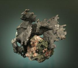 Copper, Franklin Mine, Houghton County, Michigan. Superb flat aggregates of black, tenorite coated copper crystals on matrix with small copper included calcite crystals. From the collection of J. T. Reeder. Specimen 11 cm wide. Photo by G. Robinson. (JTR 660)