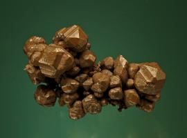 Copper, Keweenaw Peninsula, Michigan. Sharp tetrahexahedral copper crystals. Donor: L. L. Hubbard. Specimen 5 cm wide. Photo by G. Robinson. (LLH 488)
