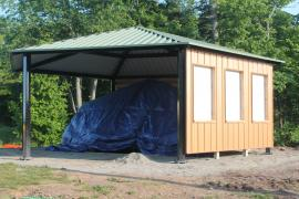 Nearly completed pavilion covering the tarped native copper slab in June 2015. Photo by T. Bornhorst.