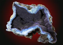 Azurite, Bisbee, Arizona. Velvety azurite filling a cavity in altered copper ore. Specimen 10 cm wide. Photo by C. Stefano. (UM11788)