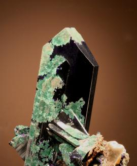 Azurite, Tsumeb, Namibia. A superb azurite crystal with partial alteration to malachite. Donor D. Gabriel. Specimen 8 cm tall. Photo by G. Robinson. (DCG 755)