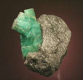 Beryl variety emerald, Ural Mts. Malyshevo, Russia. The Urals are one of the most important historical localities for emeralds. Donor: A. and C. Meieran. Specimen 9 cm tall. Photo by G. Robinson. (DM 24331)