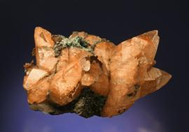 "Calcite with native copper inclusions, Quincy Mine, Houghton County, Michigan. The iconic ""Whittle Calcite"" is one of the finest large copper included calcite specimens. Donor: T. Whittle. Sepcimen 22 cm wide. Photo by G. Robinson. (TW 1)"
