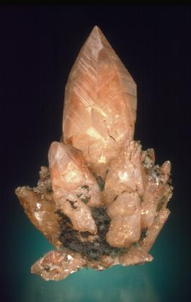 "Calcite with native copper inclusions, Franklin Mine, Houghton County, Michigan. An iconic specimen, called ""the rocket,"" is considered to be one of the finest copper included calcite specimens in the world. Specimen 8.5 cm tall. Photo by J. Scovil. (JTR 320)"