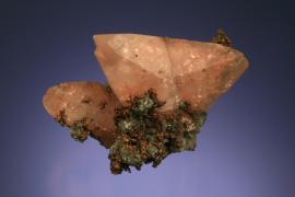 Calcite with native copper inclusions, Quincy Mine, Houghton County, Michigan. Probably the finest twinned copper included calcite specimen in the collection. From the J. T. Reeder collection. Specimen 4.5 cm across. Photo by J. Jaszczak. (JTR 389)