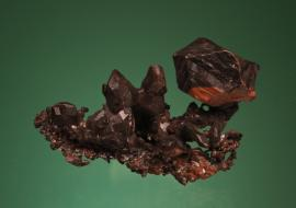 Copper, Central Mine, Keweenaw County, Michigan. Sharp copper crystals with black and red tenorite and cuprite coatings. From the collection of J. T. Reeder. Specimen 6.5 cm wide. Photo by G. Robinson. (JTR 1699)