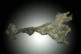 Copper, Union Mine, Ontonagon County, Michigan. A rare specimen of vein copper from a short-lived Civil War era copper mine. It was collected by Douglass Houghton's cousin, Silas Douglass. Specimen 9 cm across. Photo by C. Stefano. (UM1832)