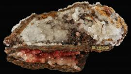 Calcite, copper, and cuprite, Bisbee, Arizona. An exceptional early specimen with old dealer price label. Specimen 13.4 cm wide. Photo by C. Stefano. (UM1764)