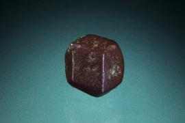 Copper, Eagle Harbor, Michigan. A small but near perfect crystal of copper showing a simple dodecahedral form. Specimen 3.5 cm across. Photo by M. Schorr.  (UM 1689)