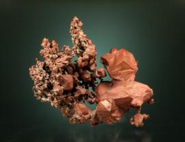 Copper, Phoenix Mine, Keweenaw Co., Michigan. An uncommon specimen with colorful cuprite and tenorite coatings. Specimen 6.3 cm tall. Photo by C. Stefano. (UM 1793)
