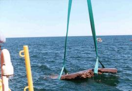 The 19-ton Lake Copper emerging from Lake Superior after being lifted from the bottomlands