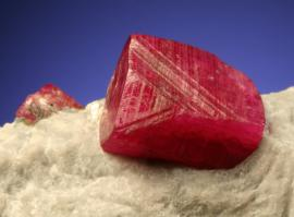 Corundum variety ruby, Jagdalak, Afghanistan. A fine ruby crystal in white marble. Field of view is about 2.5 cm wide. Photo by G. Robinson. (DM 22608)