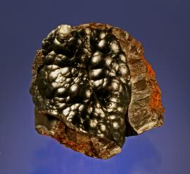Goethite, Steeprock Mine, Atikokan, Ontario. Lustrous botryoidal goethite on weathered iron ore. Specimen 9 cm tall. Photo by G. Robinson. (DM 22760)