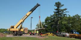 Crane lifting the 19-ton Lake Copper in preparation of placing it on a custom engineered stand. Photo by T. Bornhorst.
