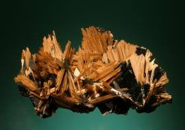Rutile and hematite, Novo Horizonte, Bahia, Brazil. Yellow needles of rutile on black hematite crystals. Specimen 9 cm wide. Photo by G. Robinson. (DM 25458)