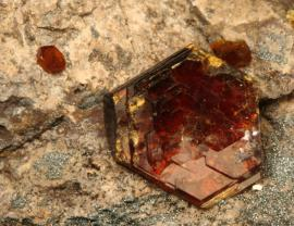 Shigaite, Bengal (Cannon) Mine, Iron County, Michigan. Micaceous brown-red shigaite crystal on matrix. Although rare, Michigan shigaites are among the best in the world. Field of view 3 cm wide. Photo by G. Robinson. (DM 27927)