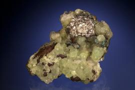 "Silver, prehnite and copper, Quincy Mine, Houghton County, Michigan. An unusual ""ball"" of silver crystals on a matrix of prehnite and copper. From collection of J. T. Reeder. Specimen 7.5 cm long. Photo by J. Jaszczak and C. Stefano. (JTR 493)"