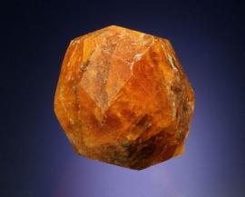 Spessartine, Nani, Loliondo, Tanzania. Spessartine is a member of the garnet group and is perhaps one of the more beautiful garnet species. These large spessartines from Tanzania are among the best. Donor: The Arkenstone. Specimen 5 cm across. Photo by G. Robinson. (DM 30129)