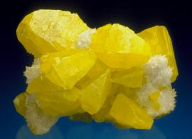 Sulfur, Maybee Quarry, Monroe County, Michigan. A fine crystal group of sulfur with calcite. Maybee sulfurs are easily North America's finest sulfur specimens. Specimen 8 cm wide. Photo by J. Scovil. (DM 23056)