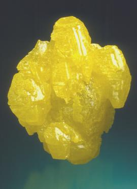 Sulfur, Maybee Quarry, Monroe County, Michigan. A large sulfur crystal with some smaller parallel crystals attached. Specimen 5.5 cm tall. Photo by J. Scovil. (DM 23134)