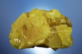 Sulfur, Racalmuto, Agrigento, Sicily, Italy. The world's finest sulfur specimens come from Sicily. This specimen was collected by University of Michigan professor Walter Hunt gifted by Hunt to E. W. Heinrich who in turn gifted his entire collection to the A. E. Seaman Mineral Museum. Donor: E. W. Heinrich. Specimen 11.5 cm wide. Photo by C. Stefano. (DM 24436)